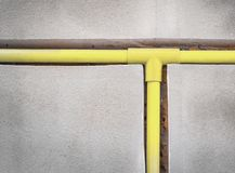 Bury a pvc pipe in the wall. Electricity system installation royalty free stock photography