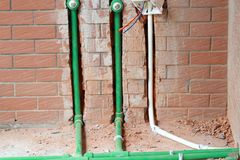 Bury a pvc pipe in the wall. Sanitary system installation royalty free stock photos
