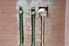 Bury a pvc pipe in the wall. Sanitary system installation stock image