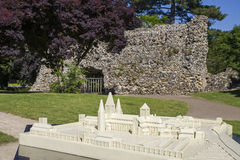 Bury St. Edmunds Abbey Ruins. A model of what the Abbey in Bury St. Edmunds once looked like, with part of the remains in the background in the Abbey Gardens Royalty Free Stock Image