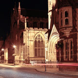 Bury St Edmunds Night Scene. Cathedral and medival buildings at night with traffic trail Royalty Free Stock Photos