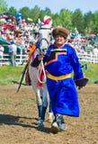 Buryat Mongolian man with white horse Stock Photo