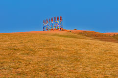 Buryat pillars. On the hill and blue sky Stock Images