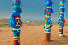Buryat pillars and village in the distance. Buryat pillars on the hill and village in the  distance Stock Images