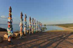 Buryat traditional pagan holy poles by Lake Baikal Royalty Free Stock Photo