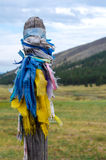 Buryat traditional pillars. With colored ribbons by Lake Baikal Royalty Free Stock Photography