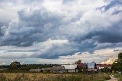 Burz chmury nad wioską Obraz Royalty Free