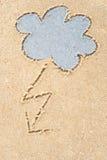 Burzowe chmury rysuje w piasku Obrazy Stock
