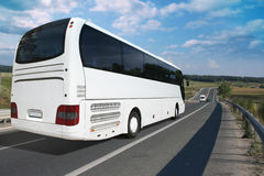 Bus. White tour bus on a highway Royalty Free Stock Photography