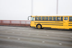 Bus. Lateral view of a school bus on a road Stock Photo