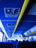 On the bus. Interior of commuter bus Royalty Free Stock Photo
