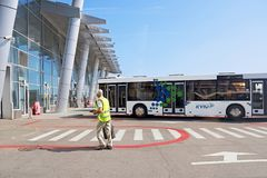 Bus, airport building and unidentified airport worker. Igor Sikorsky Kyiv International Airport Zhuliany