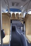 Bus aisle. Looking along the aisle of a autobus with yellow, fabric covered chairs royalty free stock photos