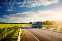 Bus on asphalt road in beautiful spring day stock photo