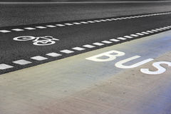 Bus and bicycle lane. On an empty road Royalty Free Stock Photo