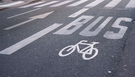 Bus and bicycle road signs. And other road surface marking elements Royalty Free Stock Image