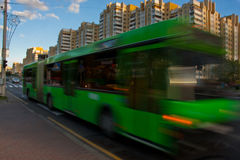 Bus with blur effect during the day. City bus traffic in the daytime along the street with a blur effect royalty free stock photo