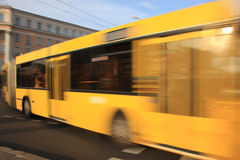 Bus with blur effect in motion. Movement yellow bus in the afternoon on the street with the effect of blurring royalty free stock photos