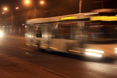 Bus Blur at Night. Public transportation bus is moving in the late evening stock photos