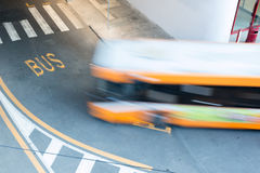 Bus in blurred motion on city road Royalty Free Stock Image