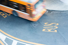 Bus in blurred motion on city road Stock Image