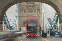 Bus Burst. Time exposure of a London Bus appearing to burst through the arches of Tower Bridge, London Stock Image