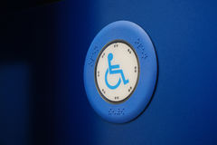 Bus button with wheelchair Royalty Free Stock Photo