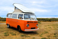 Bus camper. An orange Volkswagen bus camper with the top up Royalty Free Stock Images