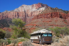Bus Camping. A bus converted into an RV is parked among the mountains of the desert southwest Stock Photo