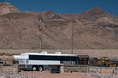 A bus carrying immigrants arrives at the US Border Patrol Station, El Paso Texas, temporary housing / processing area royalty free stock image