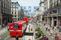 Bus Cavalcade celebration, aerial view. LONDON, ENGLAND - JUNE 22, 2014: View from the top of a double decker bus of the cavalcade of buses along Regent Street Royalty Free Stock Photos