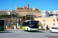 Bus with citadel to the rear, Victoria, Gozo. Green and white Malta public transport bus in the port area with views towards the citadel, Victoria Rabat, Gozo Stock Photography
