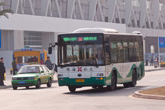 Bus in city, Zhuhai China. Zhuhai, China - Febuary 12, 2013: No. 2 Bus in zhuhai city road at Zhuhai railway station Stock Photography