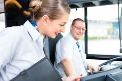 Bus or coach driver and tourist guide Royalty Free Stock Photos