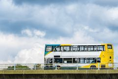 Bus coach on uk motorway ober cloudy sky background.  stock image