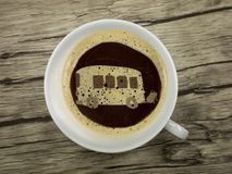 Bus in coffee cup Stock Image
