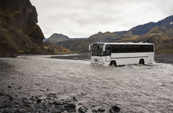 Bus crossing river Stock Image