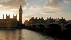 Bus crossing Westminster Bridge at sunset