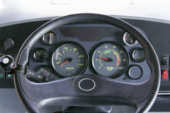 Bus dashboard. Steering wheel, dashboard, speedometer and tachometer of a bus Stock Images