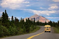 Bus in Denali with Mountain Royalty Free Stock Photography