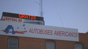 Bus Depot Near the Mexico Border. Pan shot of a bus depot near the Mexican American border stock footage