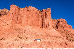 Bus and Dramatic Red Cliffs in Bolivia Stock Images