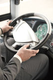 Bus driver. With hands on the steering wheel Stock Photos