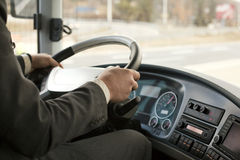Bus driver. With hands on the steering wheel Royalty Free Stock Photo