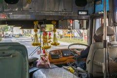 Bus driver drives bus in Bangkok Royalty Free Stock Photos