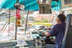 Bus driver drives bus in Bangkok Royalty Free Stock Photography