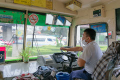 Bus driver drives bus in Bangkok Royalty Free Stock Photo