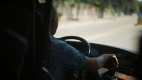 The bus driver is driving along the road. View from the bus stock video