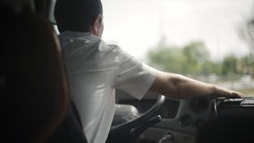 The bus driver is driving along the road. View from the bus stock video footage
