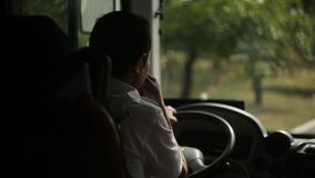 The bus driver is driving along the road. View from the bus stock footage